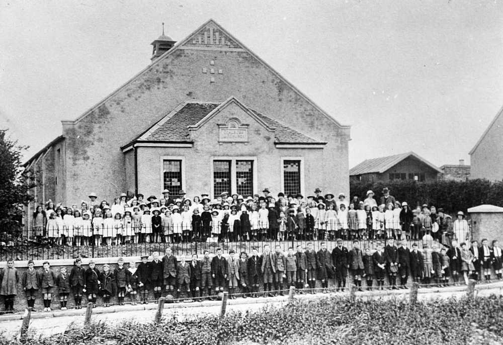 Sunday School outside rebuilt church in 1920s