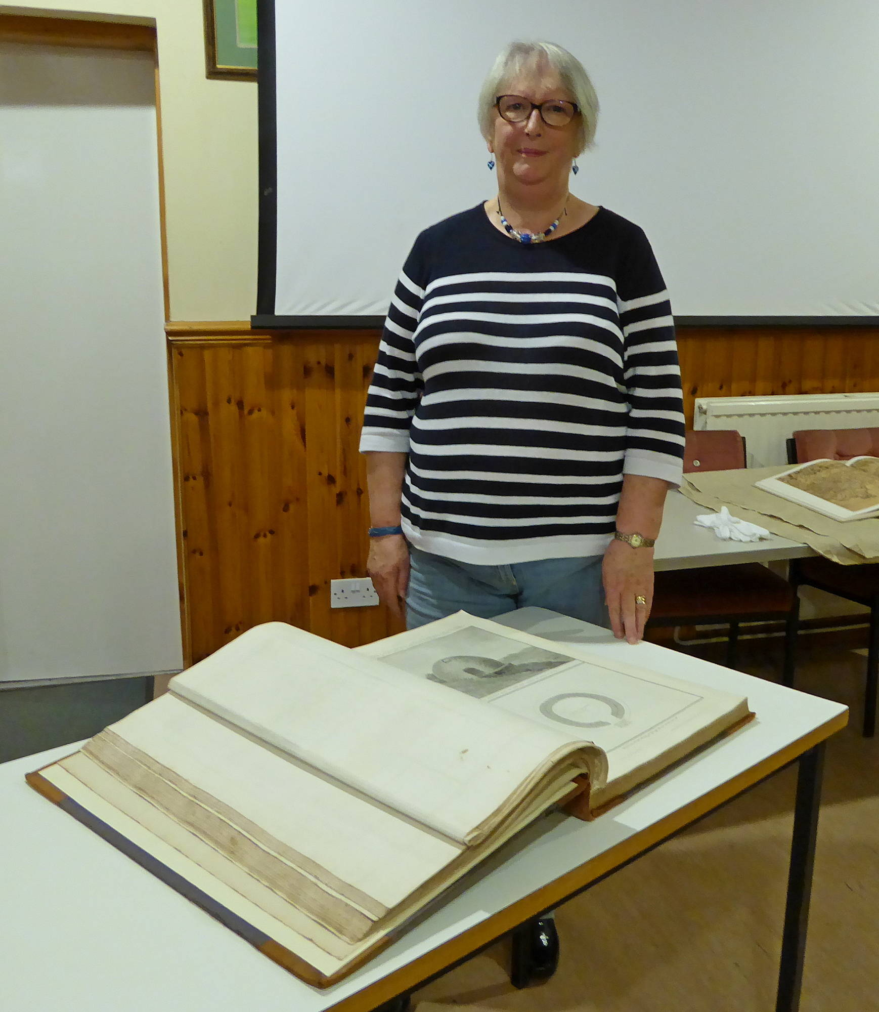 Joan Barr with a book of Roy's maps